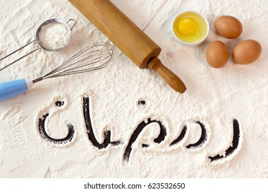 The word Ramadan ( The Muslims Holy Month ) on white flour