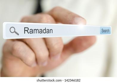 Word Ramadan written in search bar on virtual screen.