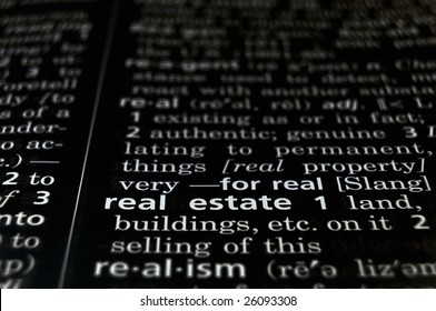 The word Real Estate in a dictionary, white on black