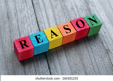 word reason on colorful wooden cubes