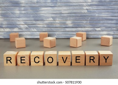 Word recovery written on wooden blocks on wall background