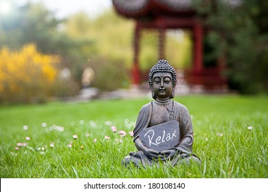 The word Relax with Buddha Statue