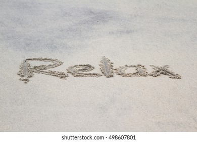 the word relax written on a sandy beach in Panama