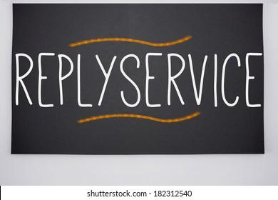 The word replyservice written on big blackboard