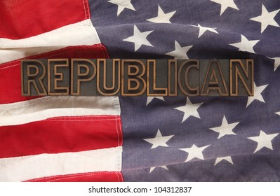 the word Republican in letterpress wood type on an old American flag