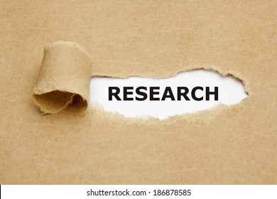 The word Research appearing behind torn brown paper.