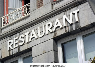 The word Restaurant at facade of old building in Wallonia, Belgium