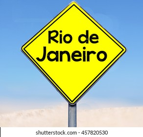Word Rio de Janeiro on road sign on sky background