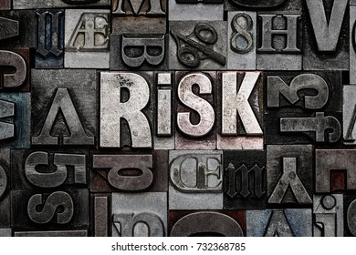 The word Risk made from old metal letterpress letters