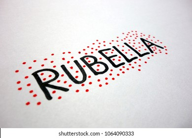 Word rubella and red dots on white paper sheet