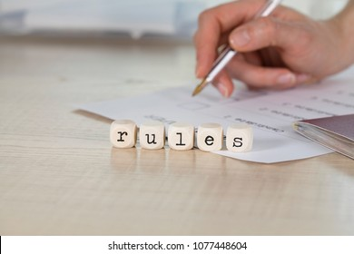Word RULES composed of wooden letters. Closeup