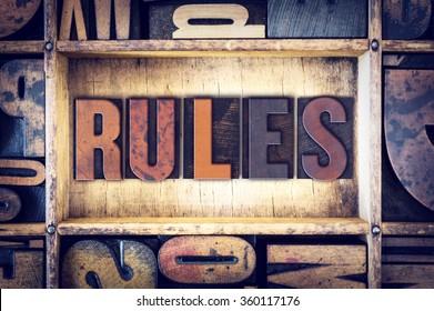 """The word """"Rules"""" written in vintage wooden letterpress type."""