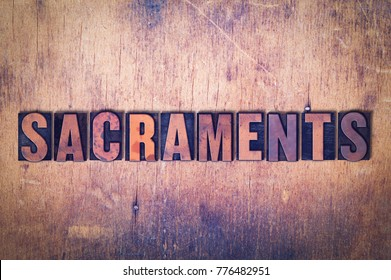 The word Sacraments concept and theme written in vintage wooden letterpress type on a grunge background.