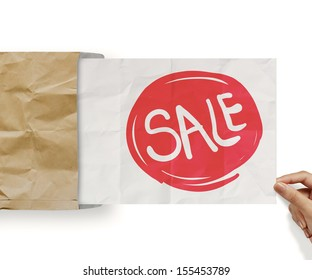 word sale with crumpled paper background as concept design