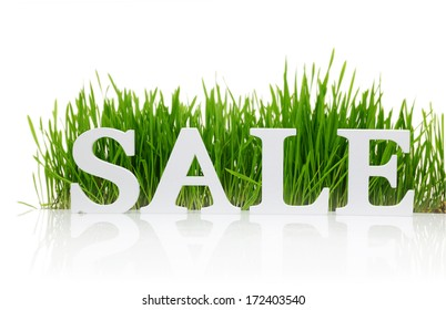 "Word ""Sale"" with fresh grass isolated on white"