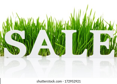"""Word """"Sale"""" with fresh grass isolated on white"""