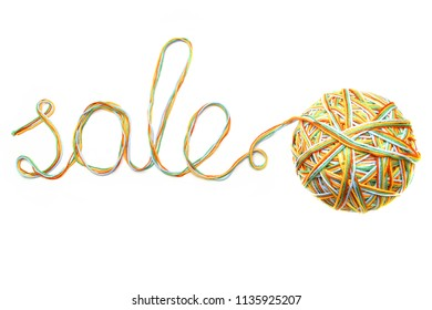 Word sale made of colorful thread and thread ball isolated on white background. Cotton yarn curly line with word sale.