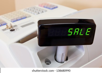 The word SALE on the display of a cash register