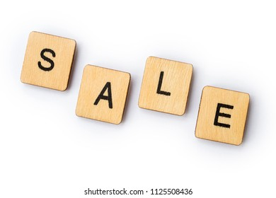 The word SALE, spelt with wooden letter tiles.