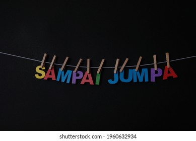 Word Sampai Jumpa on black background. Sampai Jumpa means good bye in Indonesian . Concept for art, learning, and education.