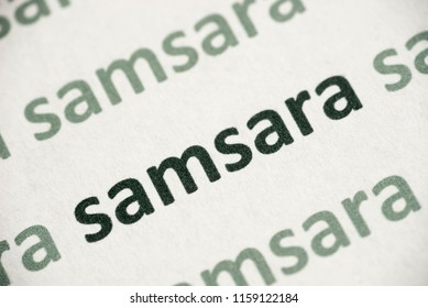 word samsara printed on white paper macro