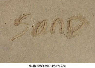 """The Word """"Sand"""" Handwritten in Sand - Background"""