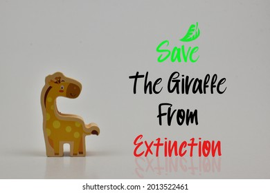 The word Save The Giraffe From Extinction and there is a wooden block has a picture of a giraffe with a white background
