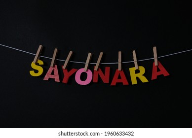 Word Sayonara on black background. Sayonara means good bye in Japanese . Concept for art, learning, and education.