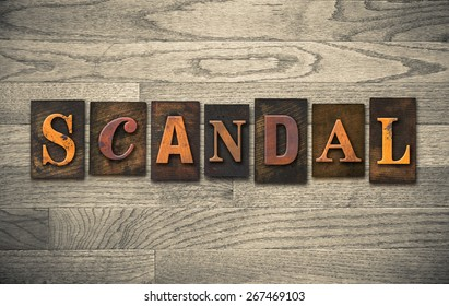 """The word """"SCANDAL"""" theme written in vintage, ink stained, wooden letterpress type on a wood grained background."""