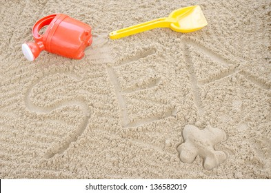 Word sea written in sand. Concept of summer holiday.