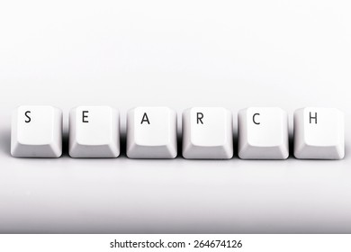 Word search formed with computer keyboard keys on white background with shadow