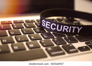 word security on labtop keyboard symbolized cyber crime protection with flare and vintage color