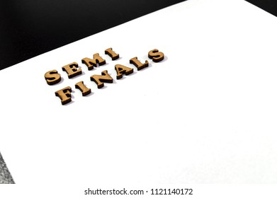Word 'Semi Finals' written with wood letters isolated on white background