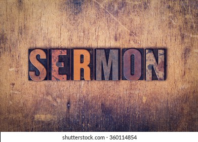 """The word """"Sermon"""" written in dirty vintage letterpress type on a aged wooden background."""