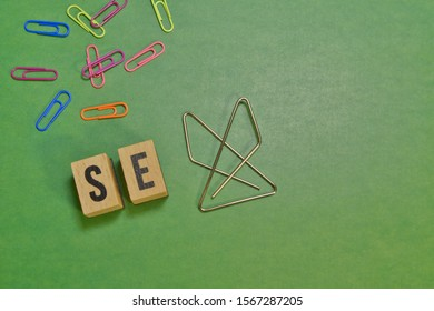 the word sex. Wooden letters and paper clip on green background. sexual harassment. Anti sexism, inappropriate behavior towards women. Hostile office environment concept. information and communication