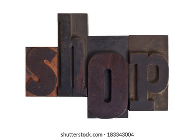 Word shop in vintage wooden letterpress type, scratched and stained, isolated on white