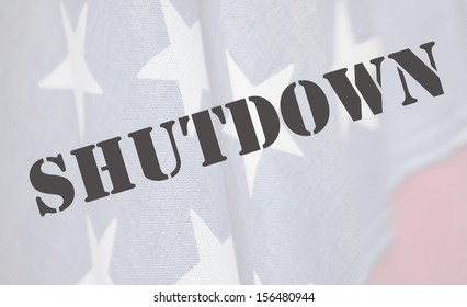 the word shutdown in a stencil font on an old USA flag