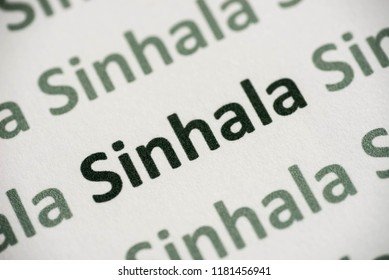 word Sinhala  language printed on white paper macro