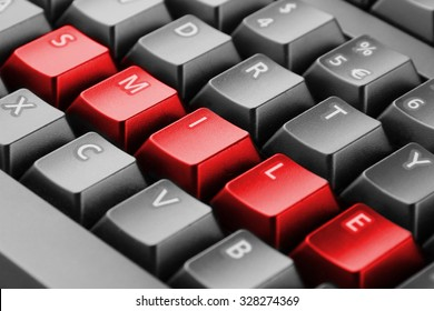 Word smile written with red keyboard buttons