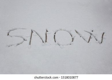 word snow written in the snow with copy space for your text