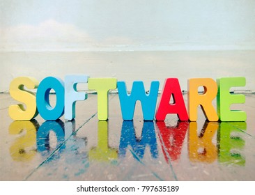 the word SOFTWARE made wit wooden letters on a wooden floor with copy space