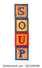 word soup spelled out with old toy wooden blocks on a white background.