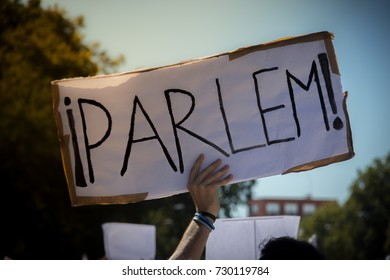 """word """"speak"""" written in Catalan on a banner during a manifestation for peace in Madrid. Spain"""