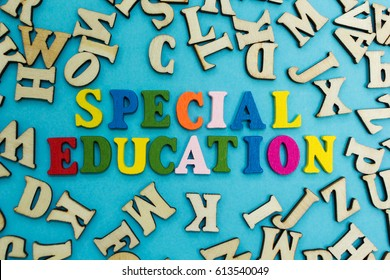 "The word ""special education"" is laid out from multicolored letters on a blue background."