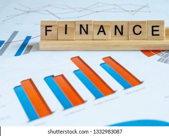 Word spell Financial over graph and chart report in the table (Business concept)