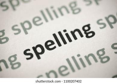 word spelling printed on white paper macro