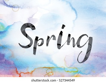"""The word """"Spring"""" painted in black ink over a colorful watercolor washed background concept and theme."""