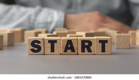 The word START made from wooden cubes. Conceptual photo. Selective focus. Shallow depth of field on the cubes