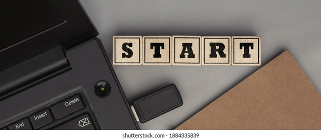 The word START made from wooden cubes. Conceptual photo. Top view