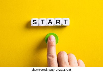 The word start on cubes with a male hand pressing the start button. To make a new start in life, business, education or career concept.